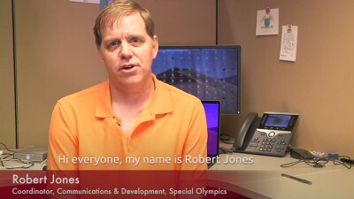 Robert Jones sitting at his desk giving a presentation.