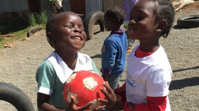 Girls from Special Olympics Kenya play with soccer ball.