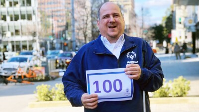Ben holding a countdown sign to the 2018 Special Olympics USA Games in Seattle