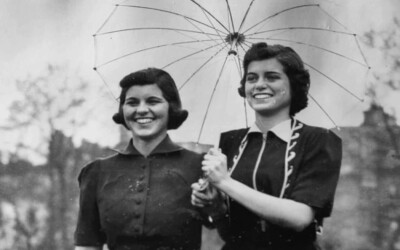Rosemary and Eunice standing under and umbrella (black and white photo)