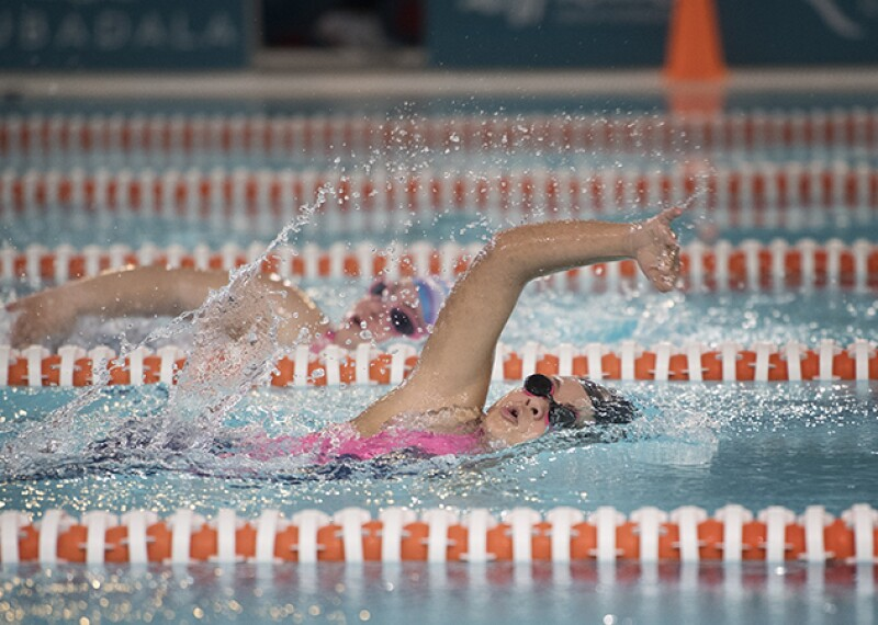 Two athletes swimming in a race.