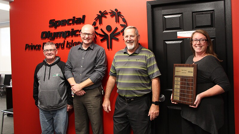 Four coaches standing in the Special Olympics Prince Edwards Island's office.