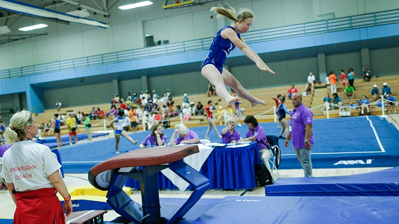 A female gymnast performing on the fault at Special Olympics World Summer Games Los Angeles 2015