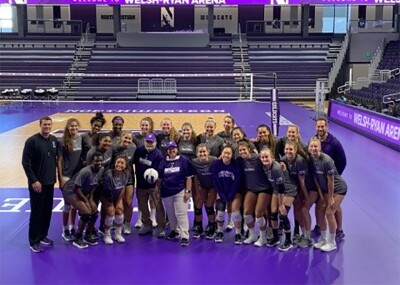 Coach Kevin and the Northwestern Women's Volleyball Team in a group picture.