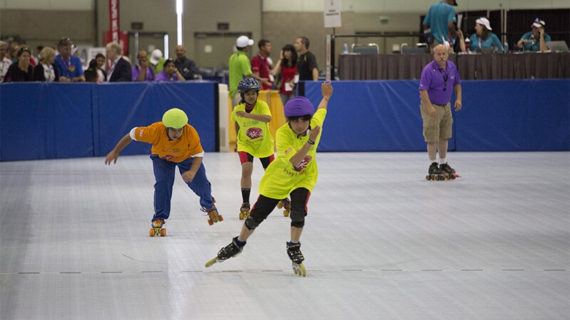 Three roller skaters racing at Special Olympics World Summer Games Los Angeles 2015