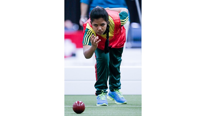 A young woman playing bocce at Special Olympics World Summer Games Los Angeles 2015