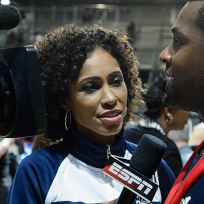 female interview with an ESPN microphone is interviewing a male player.