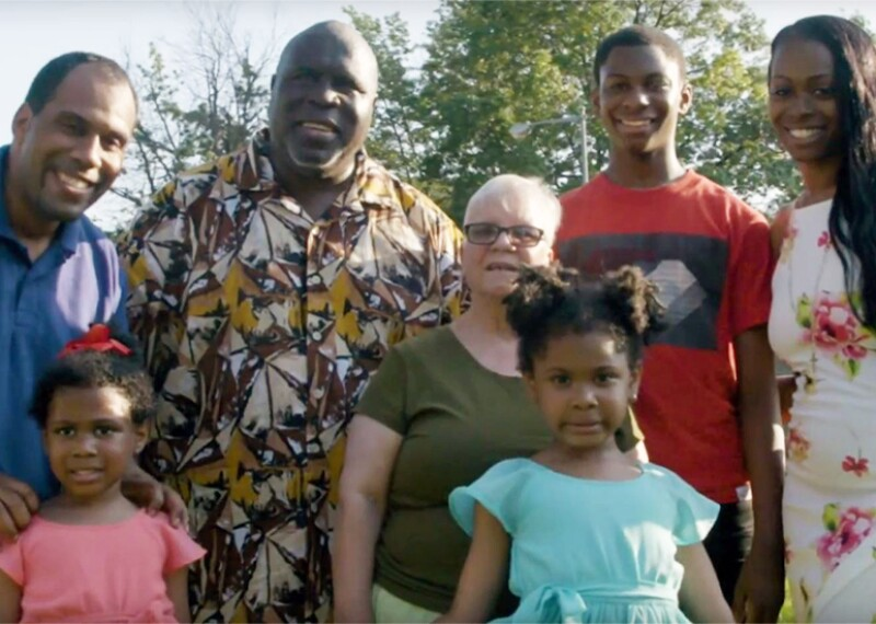 Ricardo Thornton and family standing outside for a family portrait.