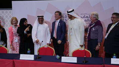 Dr. Timothy Shriver stands in the middle of representatives from the Abu Dhabi along with Mary Davis at the Special Olympics World Games 2019 closing press conference.