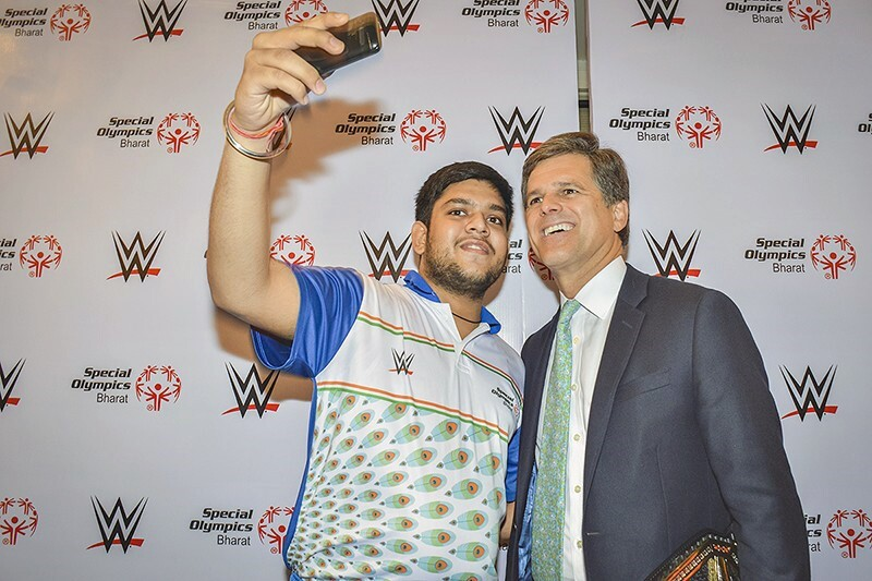 Shrey Kadian stands next to with Dr. Timothy Shriver, Special Olympics Board Chair and is taking a selfie.