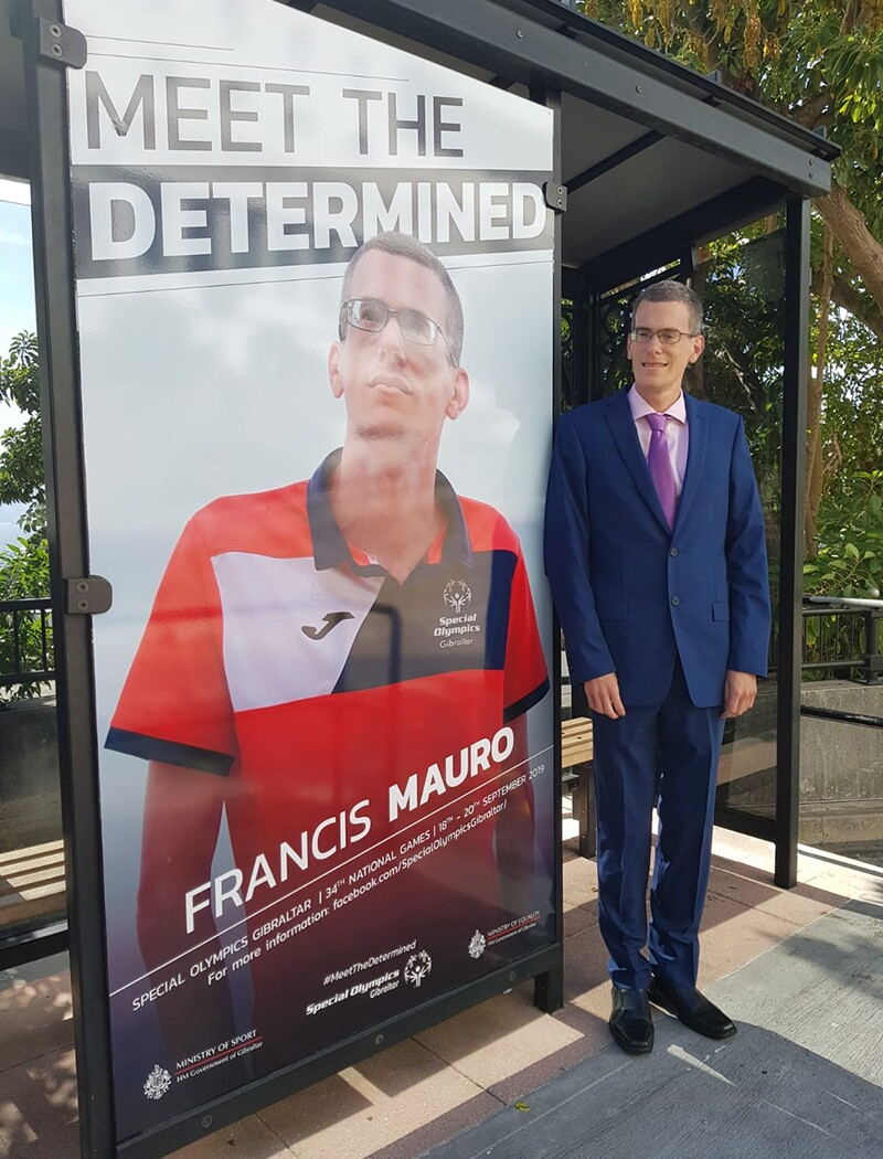 Special Olympics Gibraltar athlete Francis Mauro stands proudly alongside his poster ahead of Special Olympics Gibraltar National Games in September 2019.