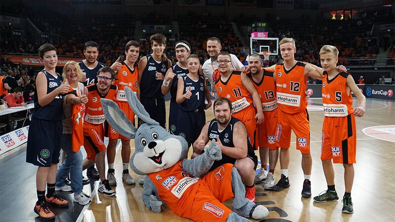 2017 European basketball teams on the court with a person dressed up as the rabbit mascot.