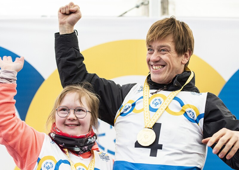 Sofia Storling and Cyril Lamalle celebrate at the medal ceremony for the Alpine Skiing competition.