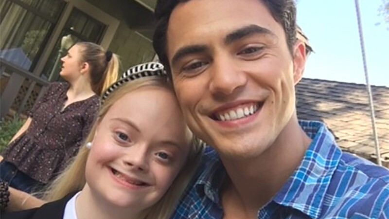 Lily and Darren Barnet standing together for a selfie.