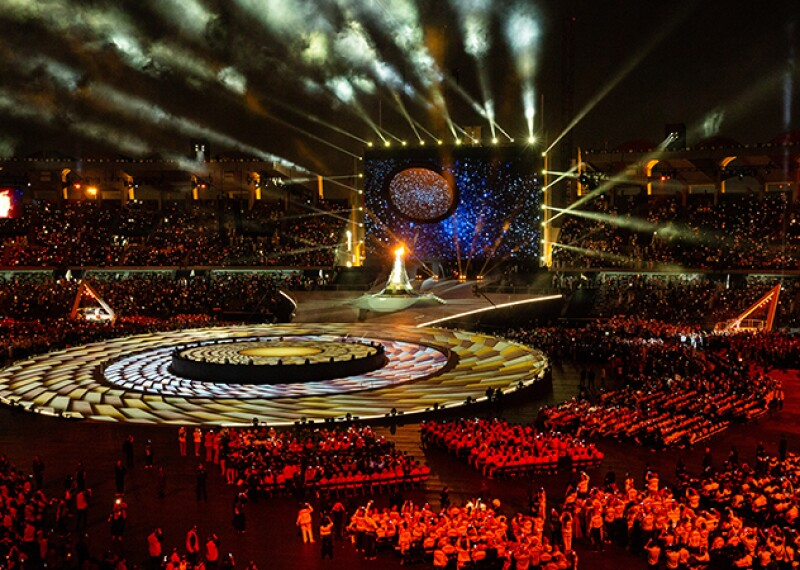 Special Olympics World Games Abu Dhabi 2019  opening ceremony stage, athletes seated, red lights and full light show action on stage.
