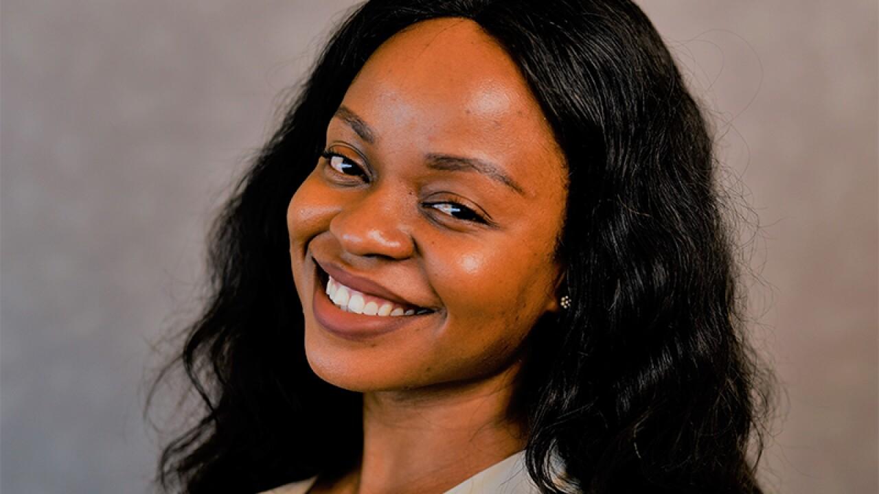 Headshot of Tanya smiling at camera