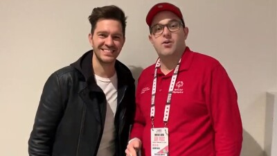 Andy Grammer and Daniel Smorowski standing side by side for a Dan's podcast interview.