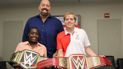 Novie Craven and Bobby Jones holding WWE championship belts along with Big Show.