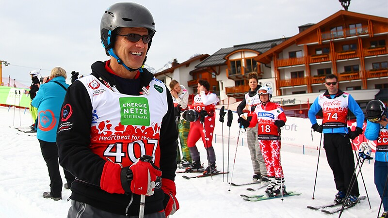 Special Olympics Chairman of the Board Timothy Shriver standing in the snow in his skiing gear.
