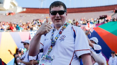 Athlete giving a thumbs up at a games event.