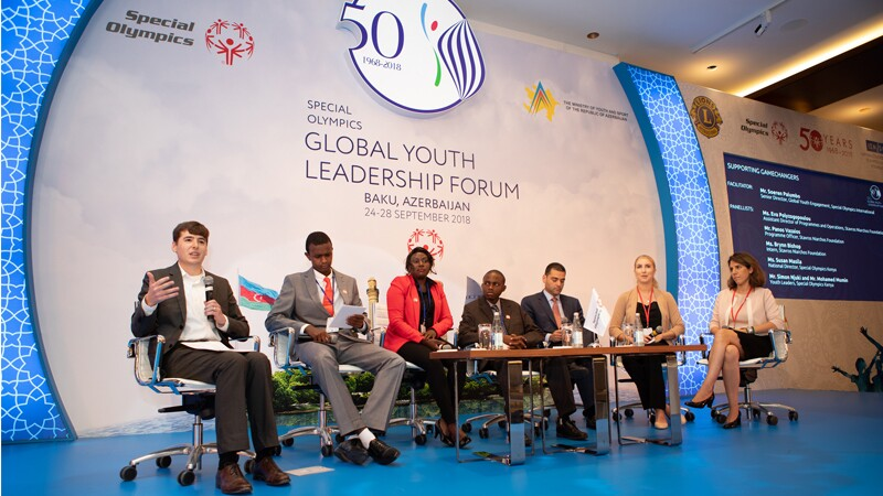 Seven Youth Leaders are seated on a panel at the Global Youth Leadership Forum in Baku.