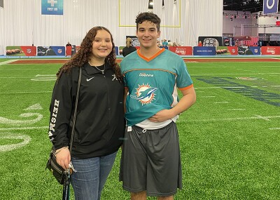 Logan and Maya at an indoor football facility.