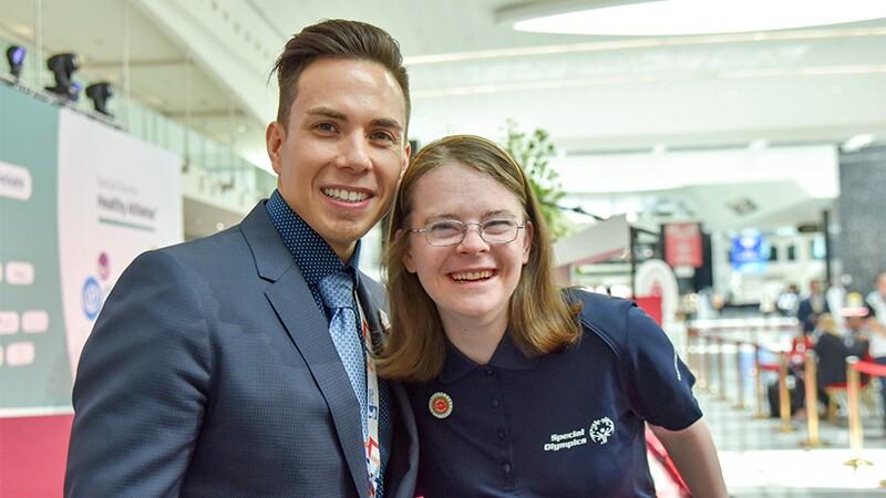 Special Olympics International Global Ambassador Apolo Ohno with Hanna Atkinson, Sargent Shriver International Global Messenger from Special Olympics Colorado.