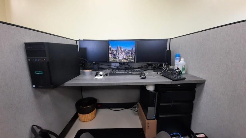 A computer station is set up on a desk.