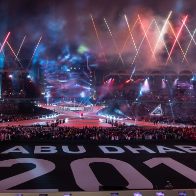 fireworks launching in an open arena. the text on the ground reads: abu dhabi 2019