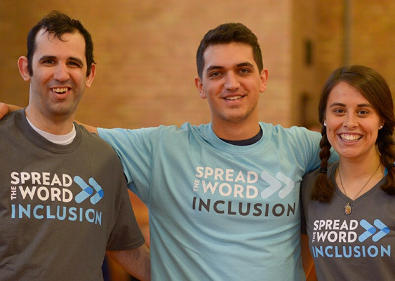 Three athletes and Spread the Word Inclusion representatives standing side by side, all three are wearing Spread the Word Inclusion t-shirts.