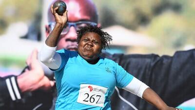 Woman throws shotput