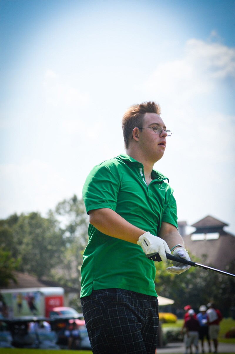 Chris swings a golf club.