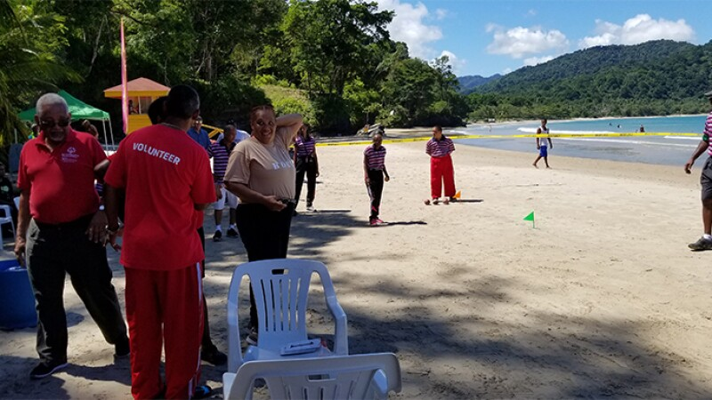 Volunteers and players on the beach at the Bocce area during the 2018 Beach Games in Trinidad.