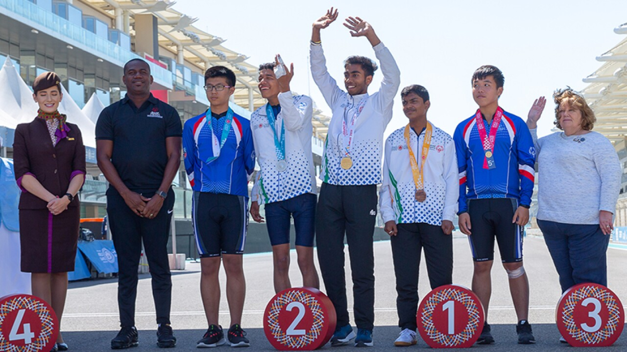 8 people, from the left, one Ethiad representative, a male trainer, 5 athletes including Abhishek with a bandage on his hand and another trainer.