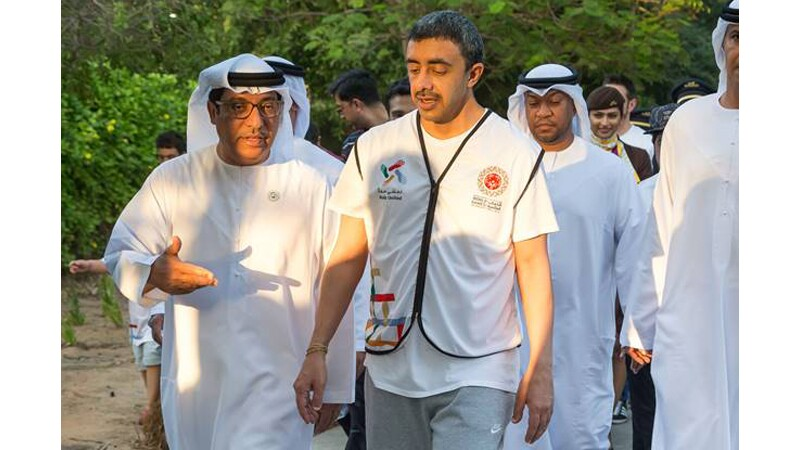 H.H. Sheikh Abdullah walks with Mohammad Abdulla Al Junaibai and other members of the Higher Committee of the Special Olympics World Games 2019.