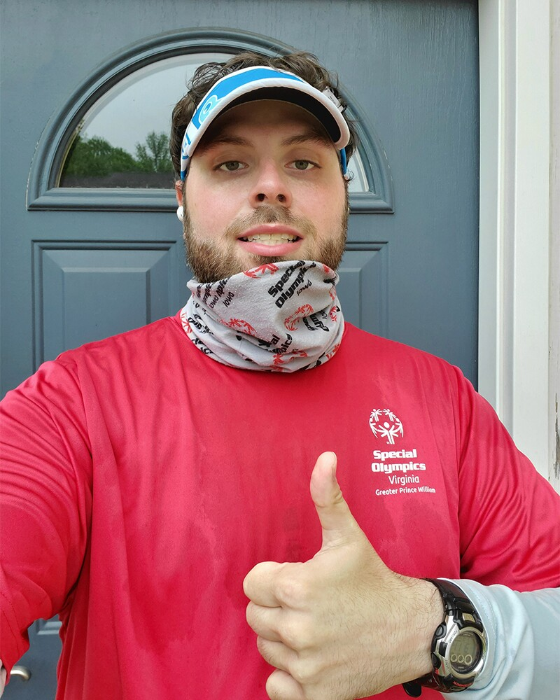 Jerry Holy giving a thumbs up in front of his front door after a run.