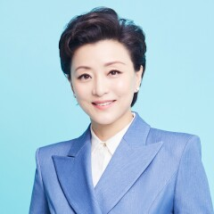Yang Lan in a blue business suite.