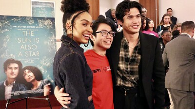 Actors Yara Shahidi, an athlete from Special Olympics New York, and Actor Charles Melton smile for a photo.