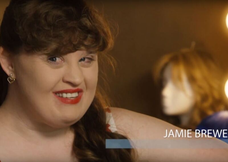 Jamie Brewer smiling.