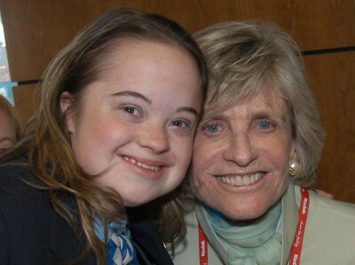 Katie Meehan and Ambassador Jean Kennedy Smith with their heads together and smiling.