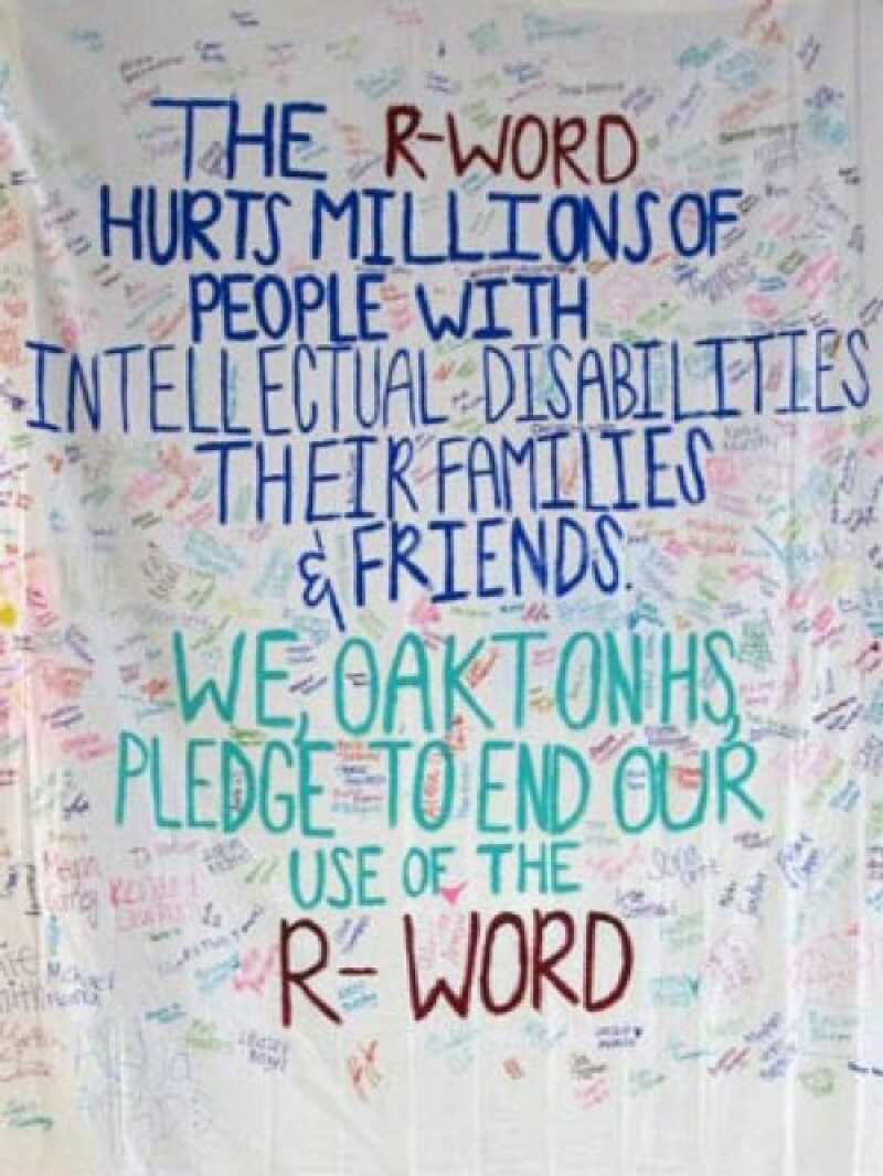 Oakton High School's R-Word Banner with signatures and text that reads: The R-Word hurts millions of people with intellectual disabilities their families and friends. We, Oakton HS pledge to end our use of the R-Word.