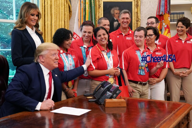 The President congratulates Delina Rodrigues, Special Olympics USA powerlifter from Pennsylvania, and her fellow Special Olympics USA athletes during a meeting with members of the USA delegation that competed at the Special Olympics World Games Abu Dhabi 2019 in the Oval Office of the White House in Washington, D.C., U.S., on Thursday, July 18, 2019.