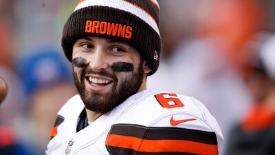 Baker Mayfield of the Cleveland Browns in his #6 jersey with a browns knitted cap on at  a game.