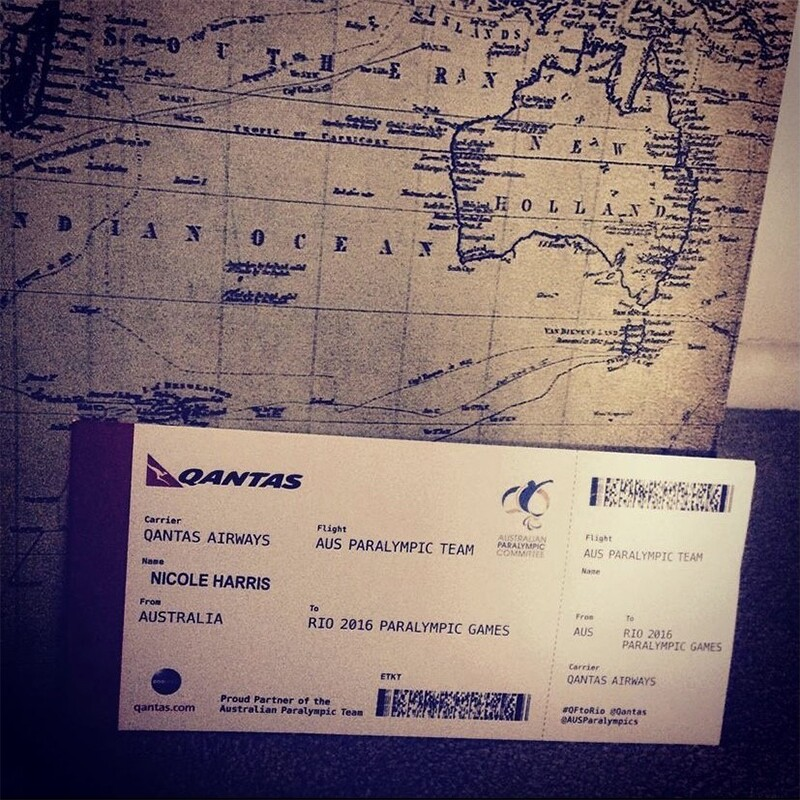 Nicole Harris' 2016 plane ticket to Rio in front of a map.