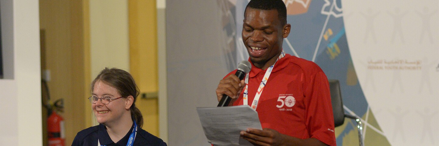 Two athletes on the stage giving a presentation