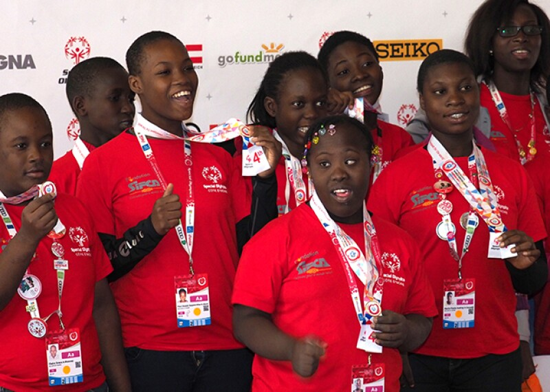 Young female and male athletes with Special Olympics Cote d'Ivoire's floorball team at the most recent World Winter Games in Austria.