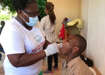 Athlete receiving an oral exam