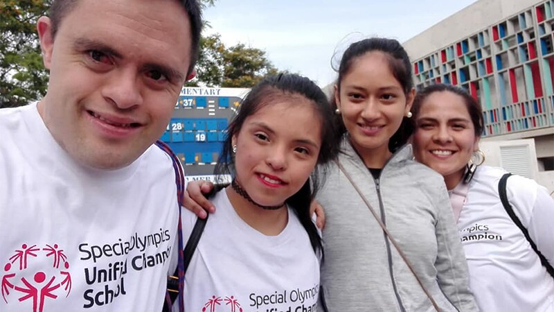 Jaime Cruz at a Special Olympics Unified Schools event in Peru with three other athletes.