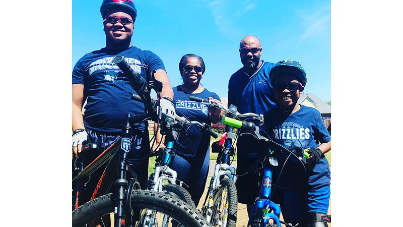 Eric and his family enjoy a bike ride together.