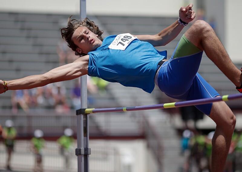 Man jumping over the highbar.